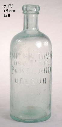 Round druggist bottle from the 1870s; click to enlarge.