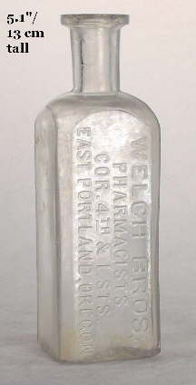 Square 1880s druggist bottle; click to enlarge.