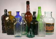 Group of historic bottles dating between 1840 and 1930.