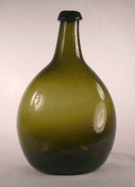 Front view of a New England chesnut flask from the early 19th century.