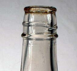 Image of a 1930's catsup bottle with a lower bead or string rim below the screw threads; click to enlarge.