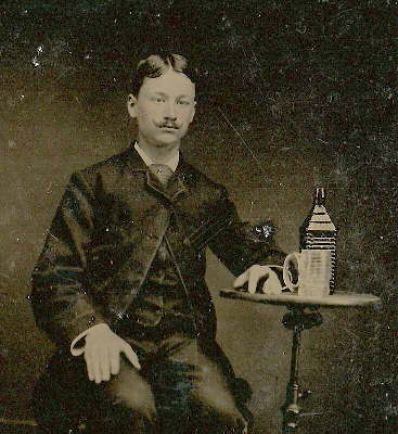 Tintype of a man and his Drake's Plantation Bitters - ca. 1865-1875.