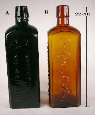 Full view of a pair of square bitters type bottles.
