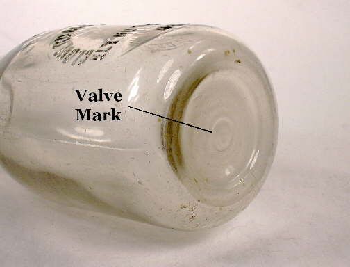 Valve mark on the base of a 1930's milk bottle; click to enlarge.
